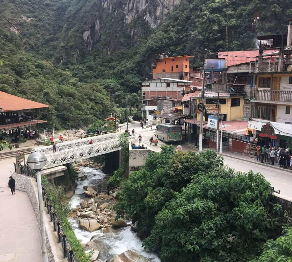 Aguas Calientes: the green bus you seen on the other side of the bridge is the bus you need to take to Machu Picchu