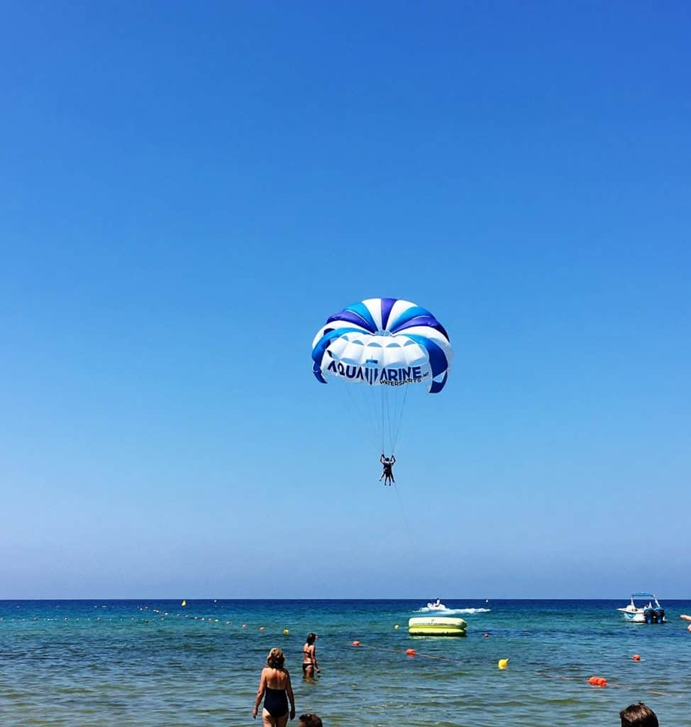 2 people doing paragliding at golden sand bay