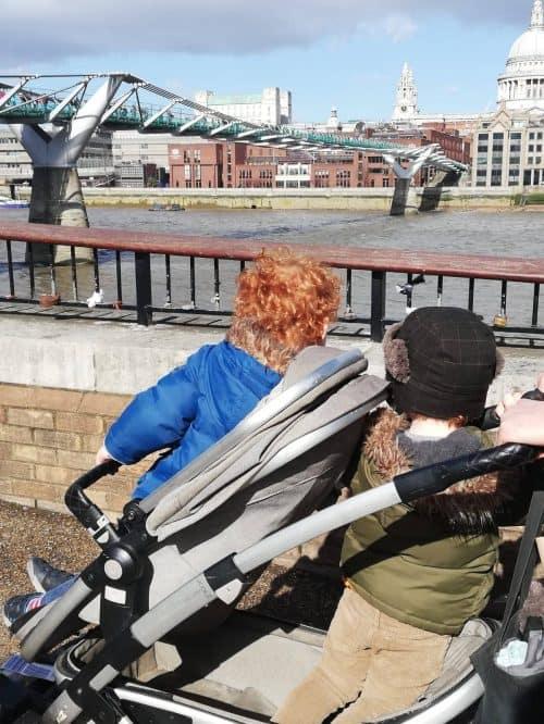 Liam and Santiago in the Joolz Geo in front of the Millenium Bridge