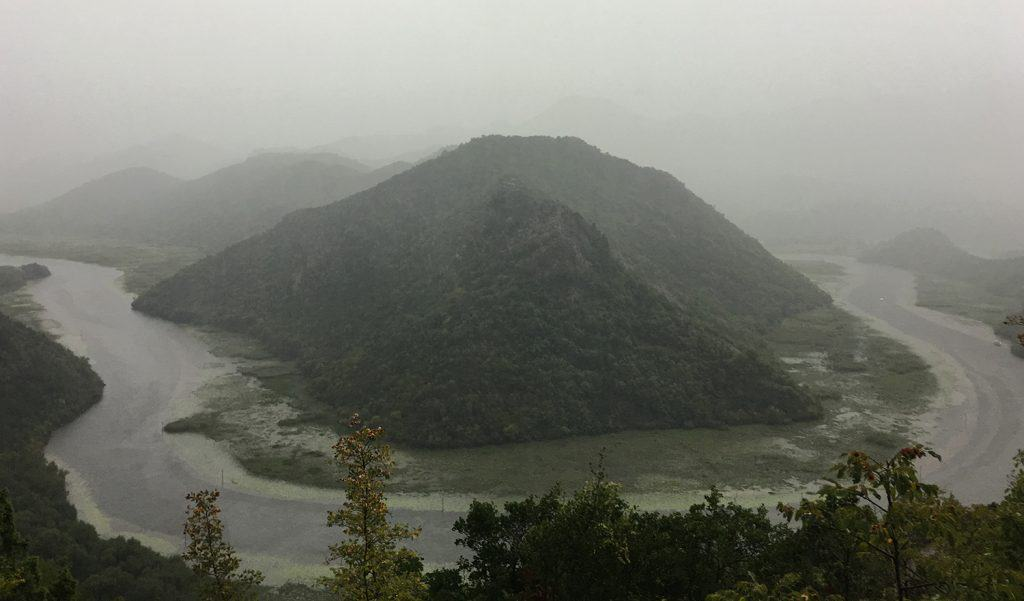 Lake Skadar: unfortunately this is the best picture I could take in the pouring rain. This iconic picture of one of Lake Skadar bend is spectacular and  usually lashing green , a part when is raining.